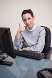Businesswoman giving thumb up Stock Photos
