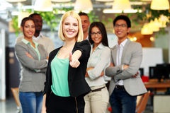 Businesswoman giving thumb up to camera Stock Photography