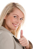 Businesswoman giving thumbs up Royalty Free Stock Images
