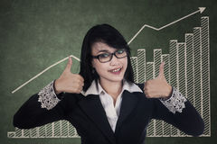 Businesswoman giving thumbs up. Beautiful businesswoman giving thumbs up sign Royalty Free Stock Photography