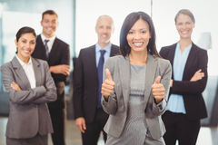 Businesswoman giving thumbs up Stock Images