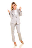Businesswoman giving thumbs up Royalty Free Stock Photo