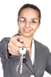 Businesswoman giving you keys Stock Photography