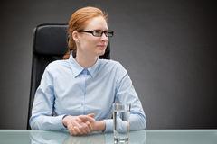 Businesswoman at a Glass Table Royalty Free Stock Photo
