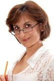 Businesswoman in glasses. Businesswoman in glasses with pencil standing against white background Royalty Free Stock Image