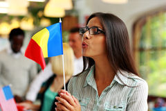 Businesswoman in glasses blowing on flag Stock Photos