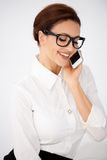 Businesswoman in glasses chatting on a mobile Royalty Free Stock Photo