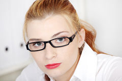 Businesswoman in glasses closeup. Royalty Free Stock Images