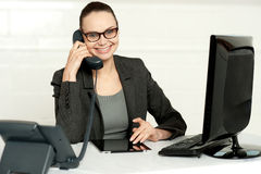 Businesswoman in glasses communicating on phone Stock Images