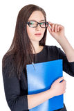 Businesswoman in glasses with folder. Portrait of happy smiling businesswoman in glasses with blue folder isolated on white background royalty free stock photography