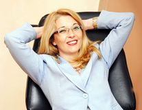 Businesswoman in glasses gesture Stock Image