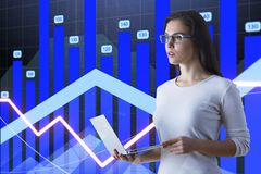 Financial chart concept. Businesswoman with glasses and laptop making presentatiton at financial chart background. 3D render Royalty Free Stock Photos