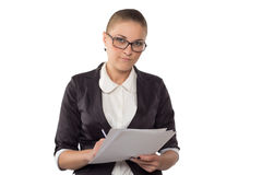 Businesswoman with glasses looking in documents Royalty Free Stock Photos