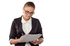 Businesswoman with glasses looking in documents Royalty Free Stock Images
