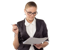 Businesswoman with glasses looking in documents Royalty Free Stock Photography