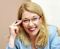Businesswoman in glasses smiling Royalty Free Stock Photo