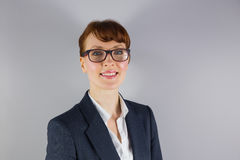 Businesswoman in glasses smiling at camera Stock Photo