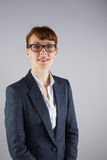 Businesswoman in glasses smiling at camera Royalty Free Stock Photography