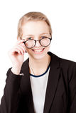 Businesswoman with glasses smiling to camera isolated. On white Stock Images
