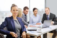 Businesswoman with glasses with team on the back Stock Photos
