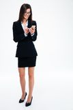 Businesswoman in glasses using smartphone Royalty Free Stock Photos