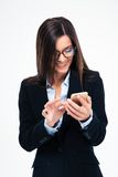 Businesswoman in glasses using smartphone Stock Photo