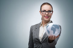 The businesswoman in global business concept Stock Photo