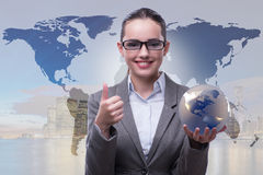 The businesswoman in global business concept Stock Images