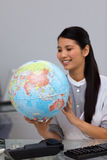 Businesswoman with a globe Stock Image