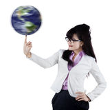 Businesswoman with globe on finger 1 Stock Photo