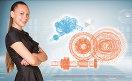 Businesswoman and glow wire-frame gears Stock Photography