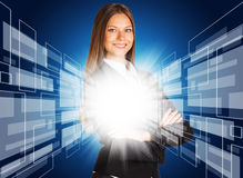 Businesswoman with glowing abstract background Stock Image
