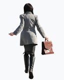 Businesswoman on the go. Businesswoman on the run with a portfolio in her right hand Royalty Free Stock Photography