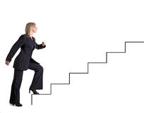 Businesswoman goes upstairs. Businesswoman shows the growth of her carrier Stock Images