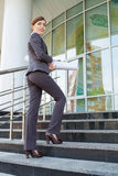 Businesswoman goes upstairs. Stock Images