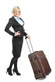 Businesswoman going on a business trip. Isolated on white background Stock Photography