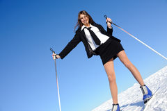 Businesswoman going to ski Royalty Free Stock Image