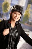 Businesswoman going to work by bike Royalty Free Stock Image