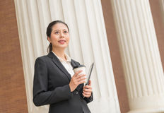 Businesswoman going to work with coffee cup Royalty Free Stock Image