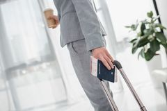 Businesswoman going on trip. Cropped shot of businesswoman with luggage and flight ticket going on trip Royalty Free Stock Images
