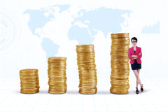 Businesswoman and gold coins chart Royalty Free Stock Images