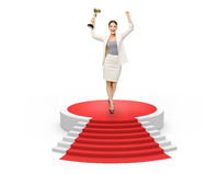 Businesswoman with gold cup on red carpet, Royalty Free Stock Photos