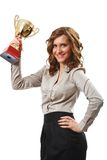 Businesswoman with golden cup. Portrait of a young businesswoman holding a golden cup, symbol of success in business Royalty Free Stock Photo