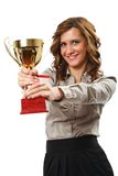 Businesswoman with golden cup. Portrait of a young businesswoman holding a golden cup, symbol of success in business Royalty Free Stock Image
