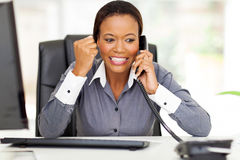 Businesswoman good news. Excited african american businesswoman hearing good news on the phone Royalty Free Stock Photography