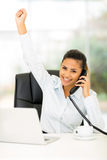 Businesswoman good news. Excited businesswoman hearing good news on the phone Stock Photography