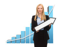 Businesswoman with graph and arrow directing up Royalty Free Stock Photos