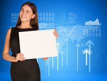 Businesswoman with graphs, arrows and world map. Businesswoman hold paper sheet. Graphs, arrows and world map as backdrop Stock Photo