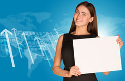 Businesswoman with graphs, arrows and world map. Businesswoman hold paper sheet. Graphs, arrows and world map as backdrop Stock Image