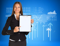 Businesswoman with graphs, arrows and world map. Businesswoman holding paper holder. Graphs, arrows and world map as backdrop Stock Photos